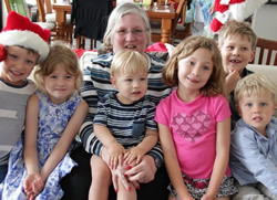 Photo of Cassandra with her grandchildren