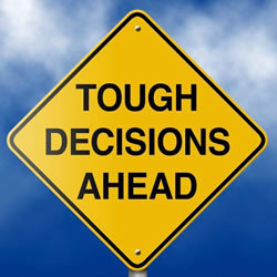 Image of tough decision sign
